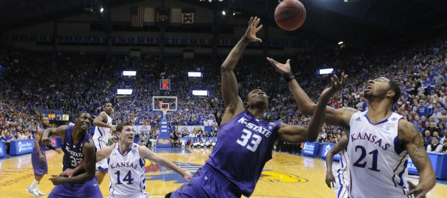 Kansas forward Markieff Morris battles for a rebound with Kansas State forward Wally Judge during the first half on Saturday, Jan. 29, 2011 at Allen Fieldhouse.