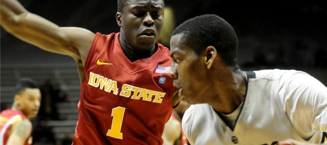 Colorado's Alec Burks, right, drives past Iowa State's Bubu Palo on Tuesday, Feb. 1, 2011, in Boulder, Colo.
