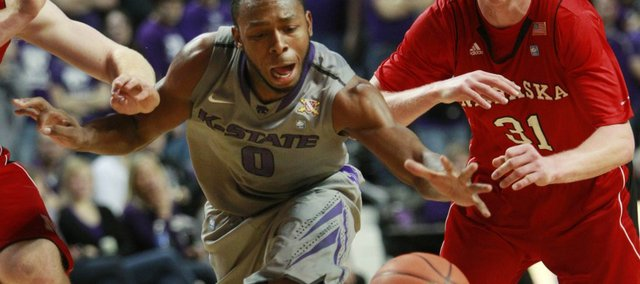 Kansas State guard Jacob Pullen (0) breaks into the lane past Nebraska guard Drake Beranek (31) during the second half Wednesday, Feb. 2, 2011, in Manhattan, Kan. Kansas State defeated Nebraska 69-53.