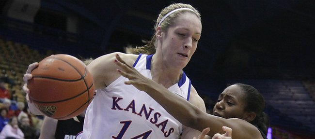 Kansas university center Krysten Boogaard (14) drives near the baseline in the second half. The senior eclipsed 1,000 career points as Kansas demolished Colorado, 81-53, on Wednesday, Feb. 2, 2011 at Allen Fieldhouse.