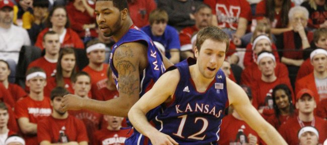 Kansas players Markieff Morris (21) and Brady Morningstar (12) celebrate a three-pointer by Morris during the second half Saturday, Feb. 5, 2011 at the Devaney Center in Lincoln, Neb. Morningstar led all KU scorers with 19 points, followed by Markieff with 17.