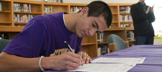 Free State senior Diego Gonzalez signs his letter of intent to play soccer for Western Illinois. Gonzalez held his signing ceremony Friday, Feb. 4, 2011 at FSHS.