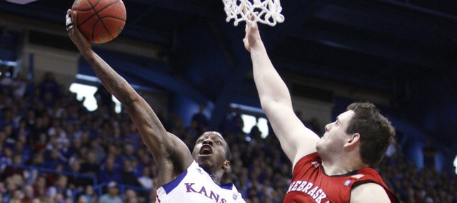 Kansas guard Tyshawn Taylor heads to the bucket against Nebraska forward Andre Almeida during the second half on Saturday, Jan. 15, 2011 at Allen Fieldhouse.