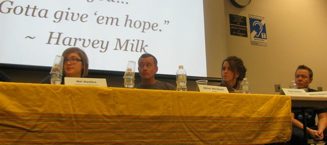 "Panelists answer questions from the crowd Saturday at the ""Bullied: We Can Make a Difference"" workshop at the Lawrence Public Library, 707 Vt. Panelists, from left to right included Mel Maddox, a Free State High student; Milton Wendland, A KU grad student and attorney; Diane Genther, coordinator of KU's LGBT Resource Center; and Matthew Blankers, a KU graduate student."