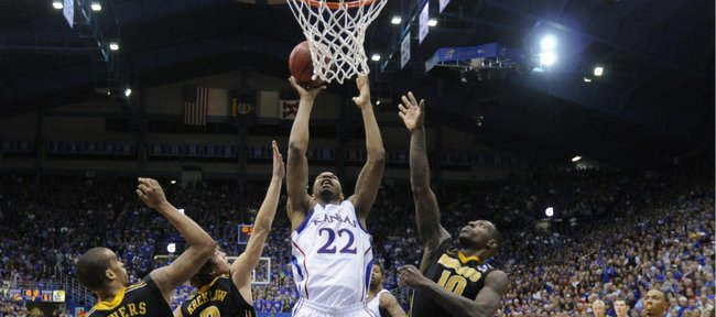 Kansas forward Marcus Morris fights Missouri defenders Laurence Bowers, Ricky Kreklow and Ricardo Ratliffe for a bucket down low between during the second half on Monday, Feb. 7, 2011 at Allen Fieldhouse.