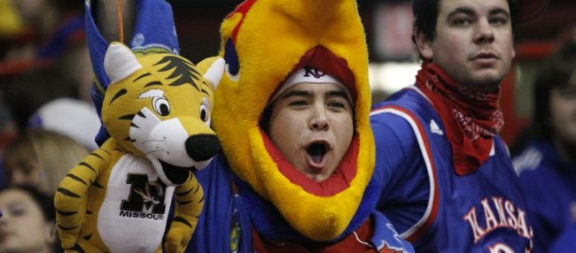University of Kansas senior Matt Rissien, Overland Park, dangles a hanging Tiger in front of the Missouri team during warmups at Allen Fieldhouse.