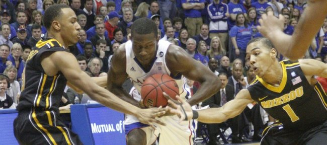 Kansas guard Mario Little controls a loose ball against Missouri's Phil Pressey (1) and Matt Pressey on Monday, February 7, 2011 at Allen Fieldhouse.