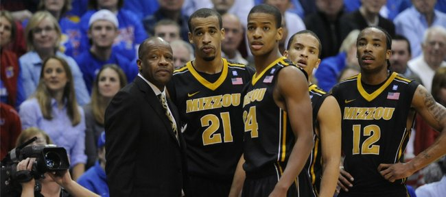 Missouri coach Mike Anderson, left, and players huddle up in the second half against Kansas on Monday, February 7, 2011 at Allen Fieldhouse.