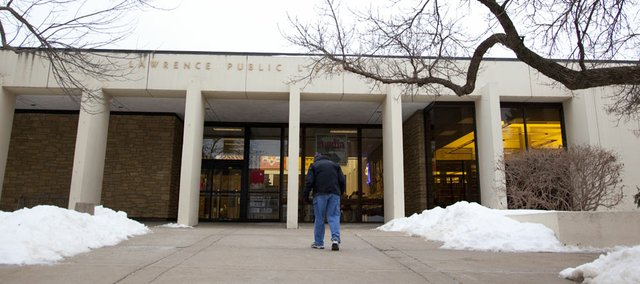 A patron make his way to the Lawrence Public Library on Tuesday, Feb. 8, 2011. City commissioners are scheduled to discuss the library design during Tuesday night's commission meeting.