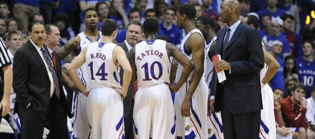The Jayhawks huddle around Kansas head coach Bill Self during a timeout late in the game against Missouri on Monday, Feb. 7, 2011 at Allen Fieldhouse.