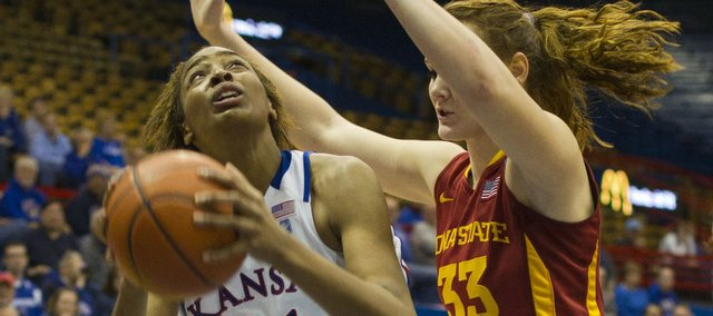 Kansas forward Carolyn Davis (21) looks to score over Iowa State forward Chelsea Poppens (33) Wednesday, Feb. 9, 2011 at Allen Fieldhouse.