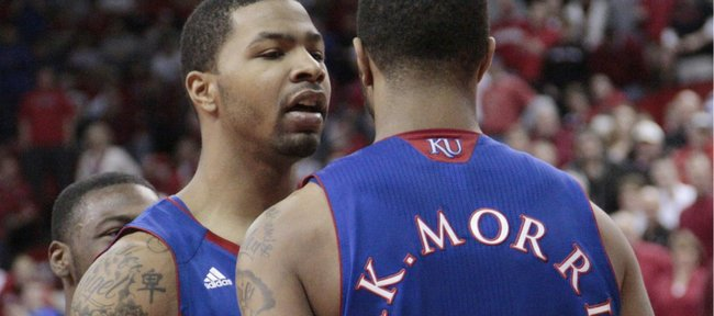 Kansas forward Marcus Morris, left, congratulates his brother Markieff after Markieff scored and was fouled during the second half against Nebraska on Saturday, Feb. 5, 2011 at the Devaney Center in Lincoln, Neb.