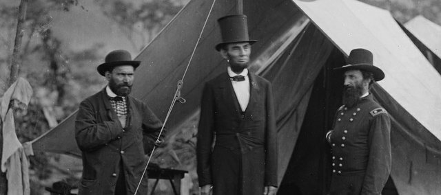 AP Photo/Library of Congress.This photo credited to Alexander Garner from 1862 at the Battle of Antietam, pictures Allan Pinkerton, Abraham Lincoln and John McClernand. The stiff poses were necessary because of the long exposures of several seconds. Note how Lincoln's face is blurred from his head moving during the exposure.