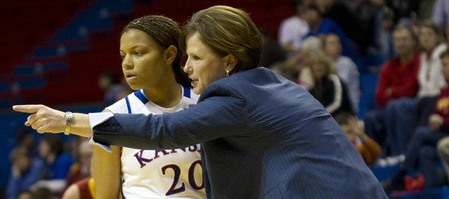 Kansas head coach Bonnie Henrickson instructs KU guard Diara Moore during a stoppage in play against Iowa State on Wednesday, Feb. 9, 2011 at Allen Fieldhouse.