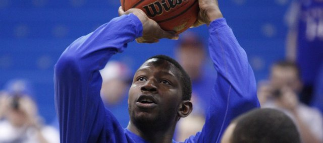 Kansas forward Mario Little puts up a shot during warmups prior to tipoff against Iowa State on Saturday, Feb. 12, 2011 at Allen Fieldhouse.