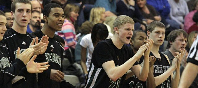 The Free State bench reacts to another score in second half action Friday, Feb. 11, 2011, as Lawrence Free State boys went against Olathe Northwest. Free State beat Northwest 57-43.