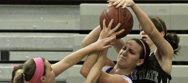 Alexa Gaumer (12) and Courtney Hoag (25) fight for the ball with Madi Haney (30) in second half action Friday, Feb. 11, 2011. Free State lost to Olathe Northwest 76-65.