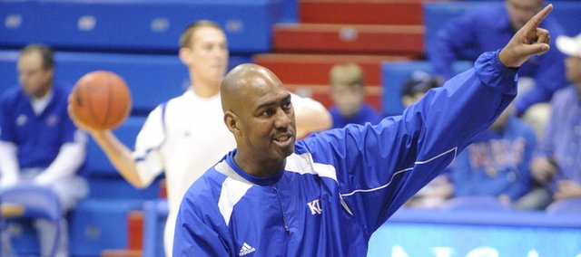 Danny Manning coaches KU players before they tip off against Oakland Wednesday, Nov. 25, 2009 at Allen Fieldhouse.