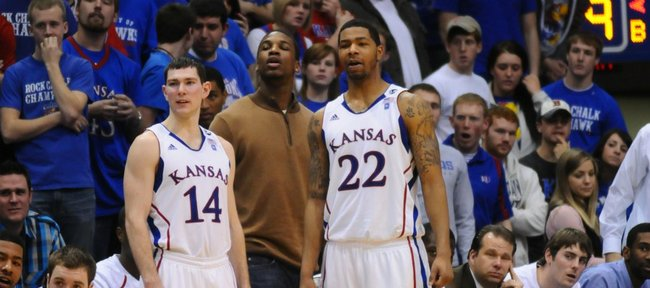 Tyrel Reed, (14) an injured Thomas Robinson, center and Marcus Morris (22) watch the final minutes of the Jayhawk's 89-66 win over Iowa State Saturday, Feb. 12, 2011 at Allen Fieldhouse.