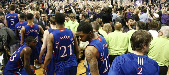 Kansas players leave the floor as the Kansas State student section rushes the court after the Wildcats defeated the Jayhawks, 84-68, on Monday, Feb. 14, 2011 at Bramlage Coliseum.