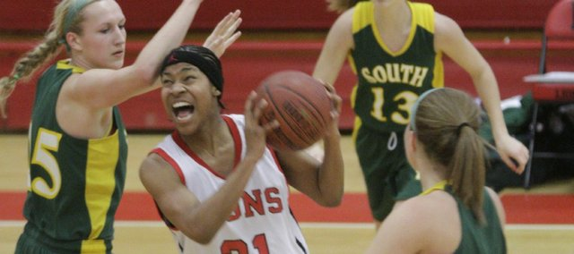 Lawrence High's TaMiya Green goes up against Shawnee Mission South on Tuesday, February 15, 2011 at LHS.