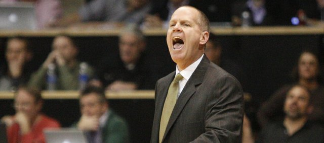Colorado head coach and former Kansas player Tad Boyle gets the attention of his team during the second half on Tuesday, Jan. 25, 2011 at the Coors Events Center in Boulder.