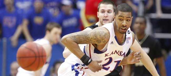 Kansas forward Markieff Morris knocks the ball away from Colorado forward Austin Dufault for a steal during the first half on Saturday, Feb. 19, 2011 at Allen Fieldhouse.