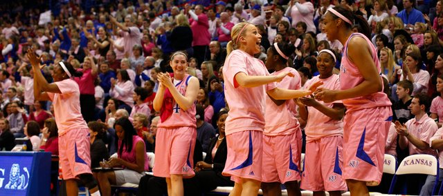 "Kansas University's Kelly Kohn, foreground left, and Carolyn Davis celebrate with the rest of the bench in this Feb. 7, 2010, file photo. The KU women will participate in their ""Think Pink"" game on Saturday against Missouri."