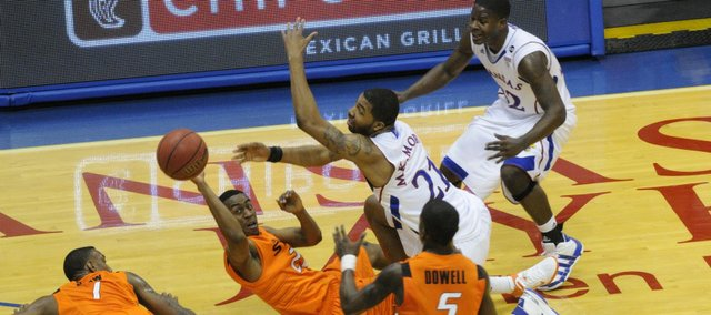 Markieff Morris (21) fights for a loose ball with Oklahoma State's Markel Brown (22) during the second half Monday, Feb. 21, 2011 at Allen Fieldhouse.