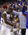 Kansas guard Elijah Johnson, left, gets a slap on the back of the head from teammate Tyshawn Taylor and a high five from Royce Woolridge after coming out of the game against Oklahoma State on Monday, Feb. 21, 2011 at Allen Fieldhouse.