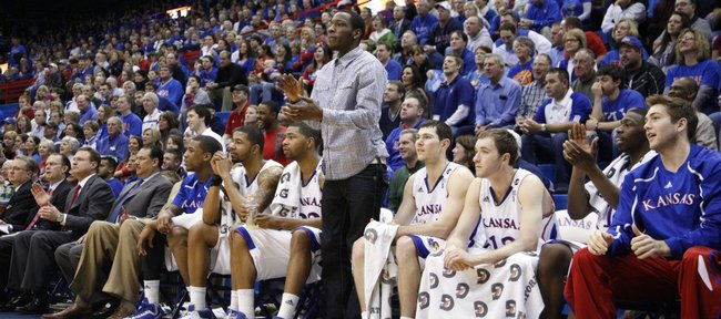 Suspended player Tyshawn Taylor stands to applaud his teammates during the second half against Oklahoma State on Monday, Feb. 21, 2011 at Allen Fieldhouse.