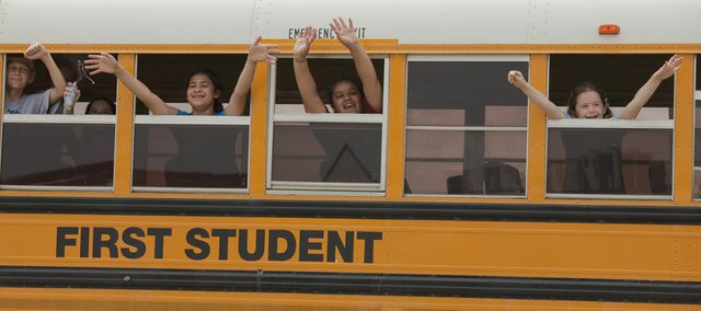 Students wave goodbye to staff and teachers at Wakarusa Valley School on the last day of school in this May 25, 2010 photo.