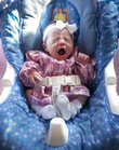 Alyssa Lynn Leming gives a big yawn in her rocker on Monday in her Lecompton home. Baby Alyssa's birth on Friday, Feb. 18, 2011 happened in an elevator at Lawrence Memorial Hospital after her mother, Crystal Leming, went into labor unexpectedly.