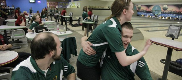 free State's Justin Walthall, right, gets a hug from Sara Perala after bowling a 278 in the second game. At left is FSHS assistant coach Tyler Bradshaw. The Firebirds boys and girls swept Lawrence High on Tuesday, Feb. 2, 2011 at Royal Crest Lanes.