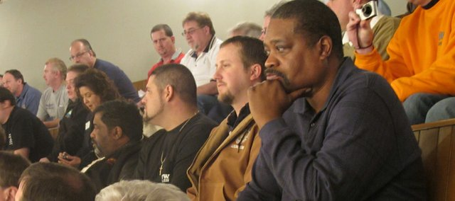 Union members watch for the vote in the Kansas House on a bill to prohibit labor organizations from deducting money from members' paychecks for dues to political action committees, Thursday, Feb. 24, 2011, at the Statehouse, in Topeka, Kan. The bill passed over vocal protests from union members in the House gallery.