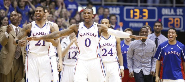 Kansas forwards Thomas Robinson (0), Markieff Morris (21) and the Kansas bench celebrate a blocked dunk by teammate Marcus Morris against Oklahoma State during the first half on Monday, Feb. 21, 2011 at Allen Fieldhouse.