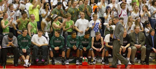 Free State head coach Chuck Law paces in front of the Firebird's bench and student section during the fourth quarter against Lawrence High on Tuesday, Jan. 25, 2011 at LHS.
