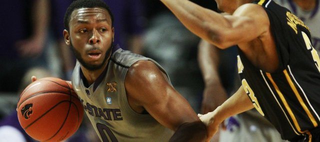 Kansas State guard Jacob Pullen (0) works against Missouri guard Matt Pressey (3) during the first half of an NCAA college basketball game Saturday, Feb. 26, 2011, in Manhattan, Kan.
