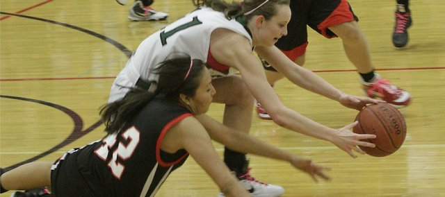 Lawrence High's Christina Haswood (42) and Free State's Kennedy Kirkpatrick (11) go for a loose ball. The Firebirds won, 55-36, Friday, Feb. 25, 2011 at FSHS.
