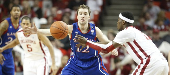 Kansas guard Brady Morningstar defends a pass from Oklahoma guard Calvin Newell Jr. during the first half on Saturday, Feb. 26, 2011 at the Lloyd Noble Center in Norman, Okla.