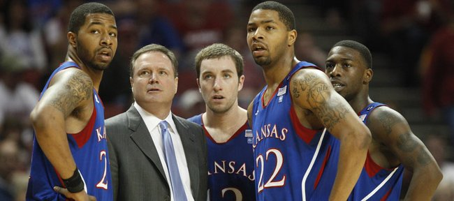 Kansas head coach Bill Self and his team watch Mario Little shoots free throws after a technical foul on Oklahoma head coach Jeff Capel during the second half on Saturday, Feb. 26, 2011 at the Lloyd Noble Center in Norman, Okla.