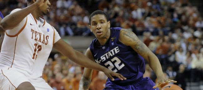 Kansas State guard Rodney McGruder, right, brings the ball up against Texas forward Tristan Thompson during the second Monday, Feb. 28, 2011, in Austin, Texas. McGruder was the high scorer for Kansas State with 22 points as Kansas State won 75-70.