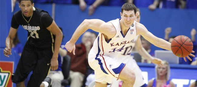 Kansas guard Tyrel Reed looks to push the ball past Colorado forward Andre Roberson during the first half on Saturday, Feb. 19, 2011 at Allen Fieldhouse.