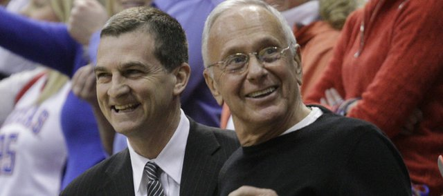 Texas A&M coach Mark Turgeon, left, and former Kansas coach Larry Brown visit before the Jayhawks take on the Aggies on Wednesday, March 2, 2011. Turgeon played on Brown's team while at KU.