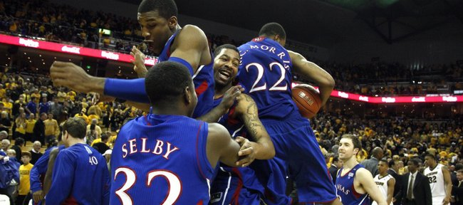 Kansas players Josh Selby, Thomas Robinson, Markieff Morris and Marcus Morris (22) collide in celebration on the court after defeating Missouri 70-66 and clinching the outright Big 12 conference championship Saturday, March 5, 2011 at Mizzou Arena.