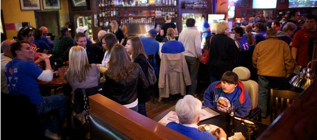 KU fans and Johnny's West patrons Kylee Manahan and Lucas Mehl, 17, bottom right, eat before the start of the KU-KSU game on March 3, 2010, at Johnny's West. Johnny's was voted the best place to watch a game.