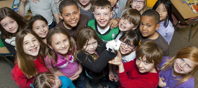 Students in Jaime Baggett's second-grade class at Deerfield School are pictured with their class pet, Sugar, an albino guinea pig.