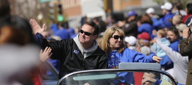 Kansas Head Coach Bill Self and his wife, Cindy, welcome the praise of thousands of KU fans as they ride in Doug Compton's car during the Jayhawks' national championship parade April 13, 2008 in downtown Lawrence. Also praiseworthy: the coach landing David Booth as keynote speaker for the 2011 Community Education Breakfast, a benefit for the Lawrence Schools Foundation. Cindy Self is a member of the foundation's board of trustees.