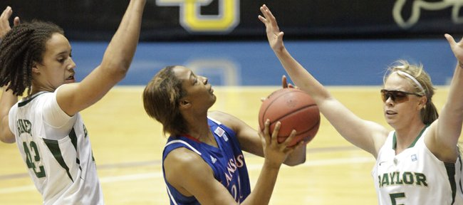 KU sophomore Carolyn Davis looks for a shot against Baylor defenders Brittney Griner and Melissa Jones. Davis scored six points during the quarterfinals of the Big 12 Women's Basketball Tournament in Kansas City, Mo., March 9, 2011.