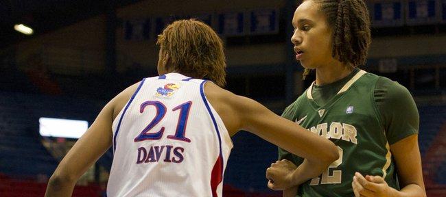 Kansas forward Carolyn Davis (21) and Baylor center Brittney Griner (42) wait for an in-bounds play Wednesday, Jan. 19, 2011 in Allen Fieldhouse.